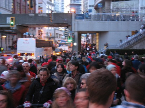 The crowds heading west toward Waterfront Station along Cordova St.