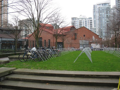 The bike valet racks. Fencing surrounds the entire bike rack space.