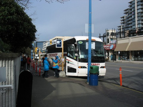 An Olympic bus parked at the departure hub at Lonsdale Quay.
