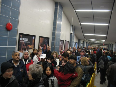 The line snaked out into the station, and then up over the plaza outside.