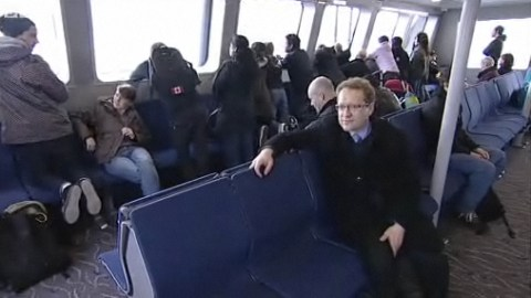 BBC reporter Adrian Warner rides the SeaBus. Screenshot from the BBC's clip about our transit system!