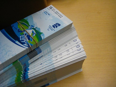 A photo of a stack of Olympic tickets. Photo by <a href=http://www.flickr.com/photos/kiwinky/4334619603/>kiwinky</a>.