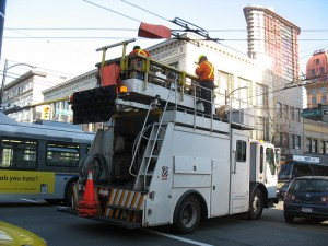 A Trolley Overhead crew repairs lines at Homer and Hastings on Friday, February 19.