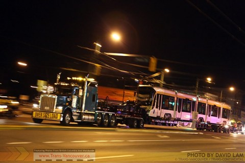 One of the Flexity streetcars being taken to Tacoma, to be shipped home to Brussels! Photo by <a href=