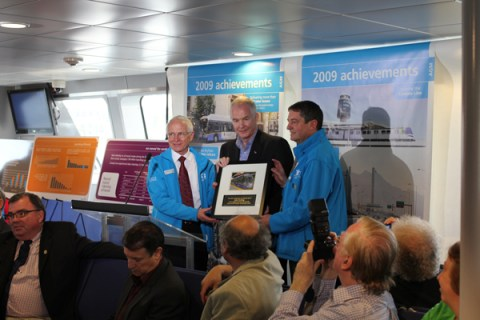 John Furlong, head of the Vancouver Olympic Organizing Committee, receives a plaque from Dale Parker and Ian Jarvis!
