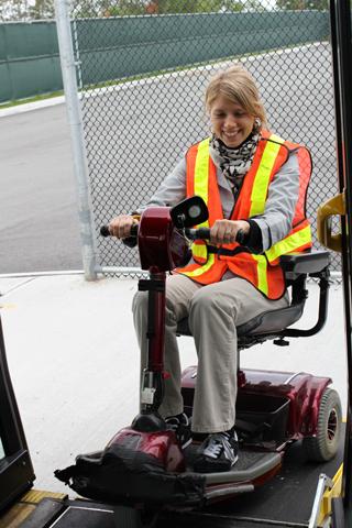 Julie boarding the diesel bus.