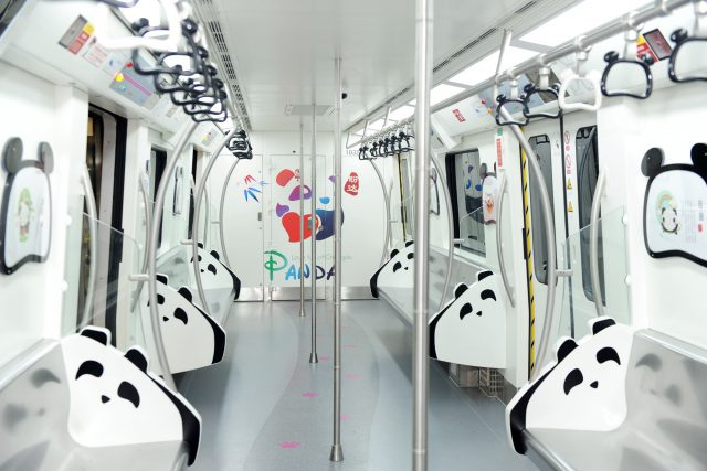 "Interior view of a panda-themed subway train of subway Line 3 in Chengdu city, southwest China's Sichuan province, 31 July 2016. A train full of Panda elements ran from Taipingyuan stop at 8:30 am on Sunday (31 July 2016), marking the official opening of the first phase of subway line 3 in Chengdu city, Southwest China's Sichuan province. During the initial operation of subway line 3, the trains operated from 6:30 am to 10:50 pm by charging passengers in accordance with their travel distances. With 2 yuan ($0.3) as the base rate, the line's total 17 stops, covering 20.3 km, cost only 4 yuan. The operation hours will be adjusted in accordance with the passenger flows. ""Subway line 3, running through the urban center, will shorten the commuters' one-way travel time to 34 minutes. However, this also means an upcoming traffic burden for the line, which is expected to witness a daily passenger flow of 400,000,"" said an insider from Chengdu Subway."