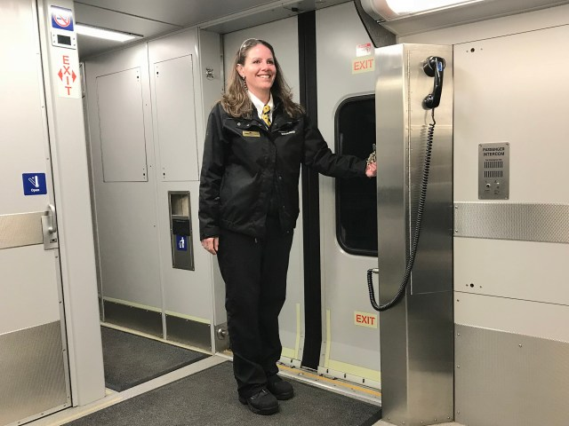Leanna Turcotte, Train Conductor for West Coast Express stands on passenger train