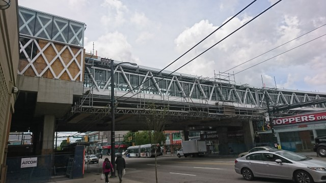 Photo of the under construction overhead walkway at Commercial–Broadway Station