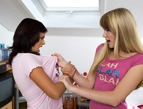 Two teenage girls (16-17) fighting Original Filename: 76551260.jpg