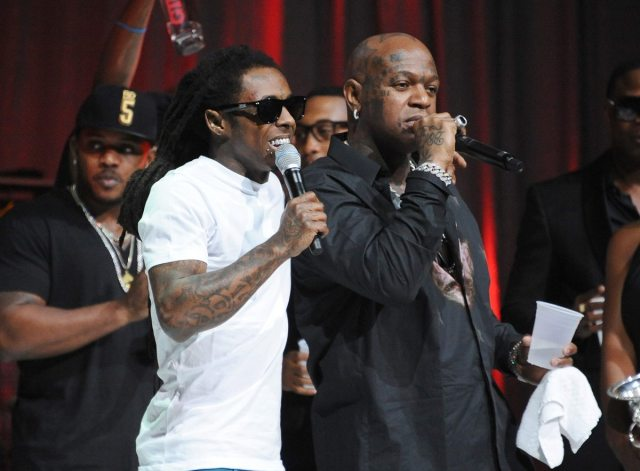 Birdman (right) performing with label mate Lil Wayne