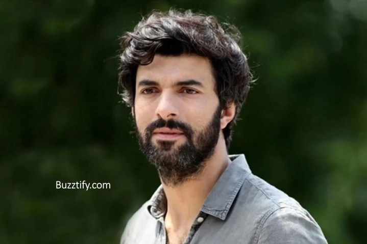 Engin Akyurek in shirt and stubble look