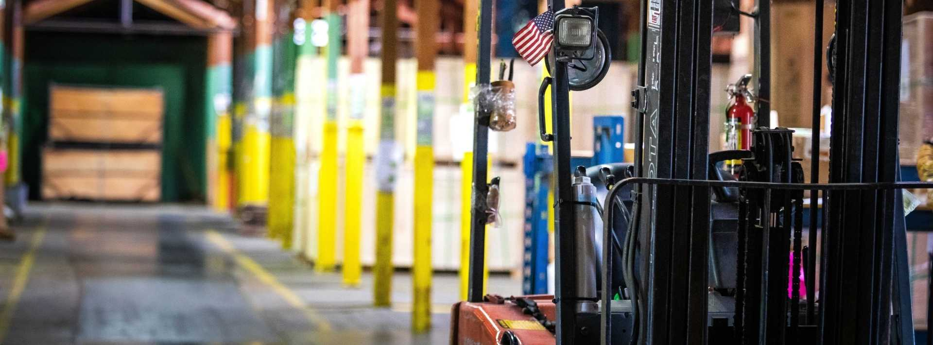 A forklift with small American flag sits in Ventamatic's bath fan warehouse in Mineral Wells, Texas.