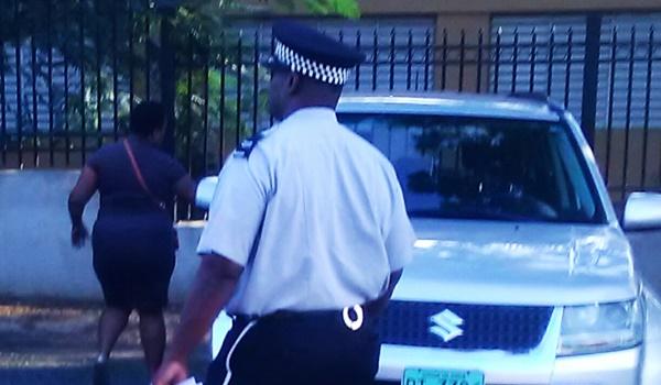 Shekima Lettsome-Joseph (background) leaving court yesterday