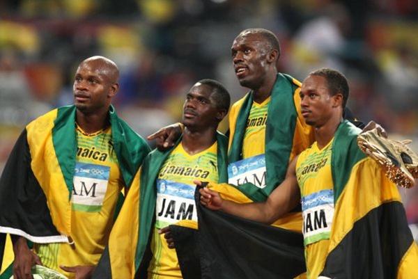 Asafa Powell, Nesta Carter (second left), Usain Bolt and Michael Frater won in Beijing for Jamaica