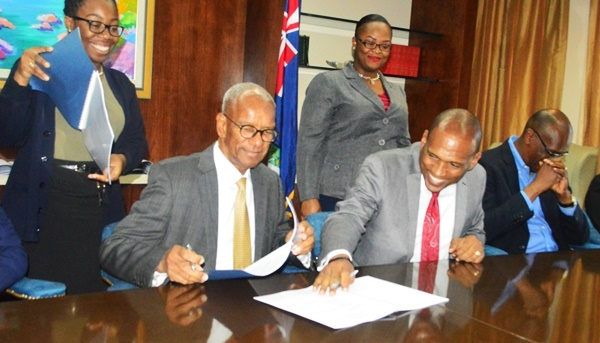 Premier Dr D Orlando Smith and Minister of Communication and Works Mark Vanterpool signed three water agreements with two companies today.