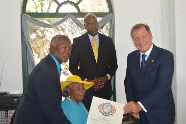 Terrence 'Chino' Chinnery receiving his award from Governor John Duncan. Those looking on are former minister responsible for sports Eileen Parsons and the current sports minister Myron Walwyn