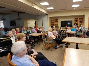 A crowd listening to Chris Sayre for National Assisted Living Week
