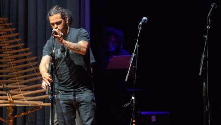 David Saenz, adjusting microphones