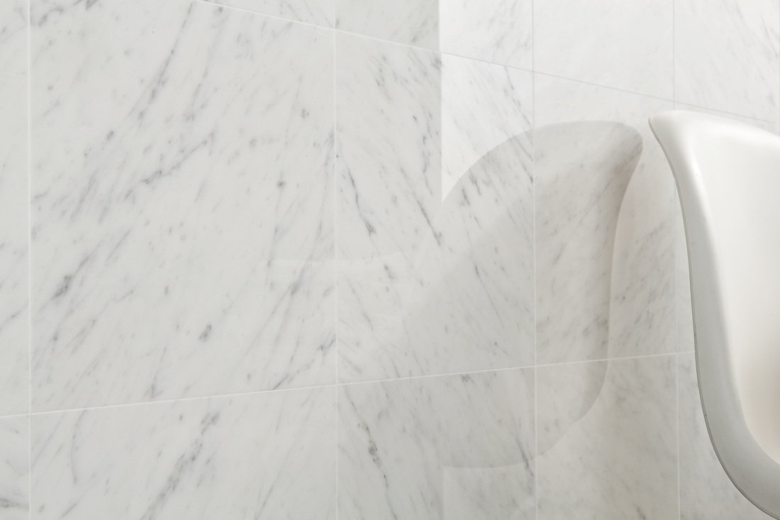 white bianco carrera marble floor and