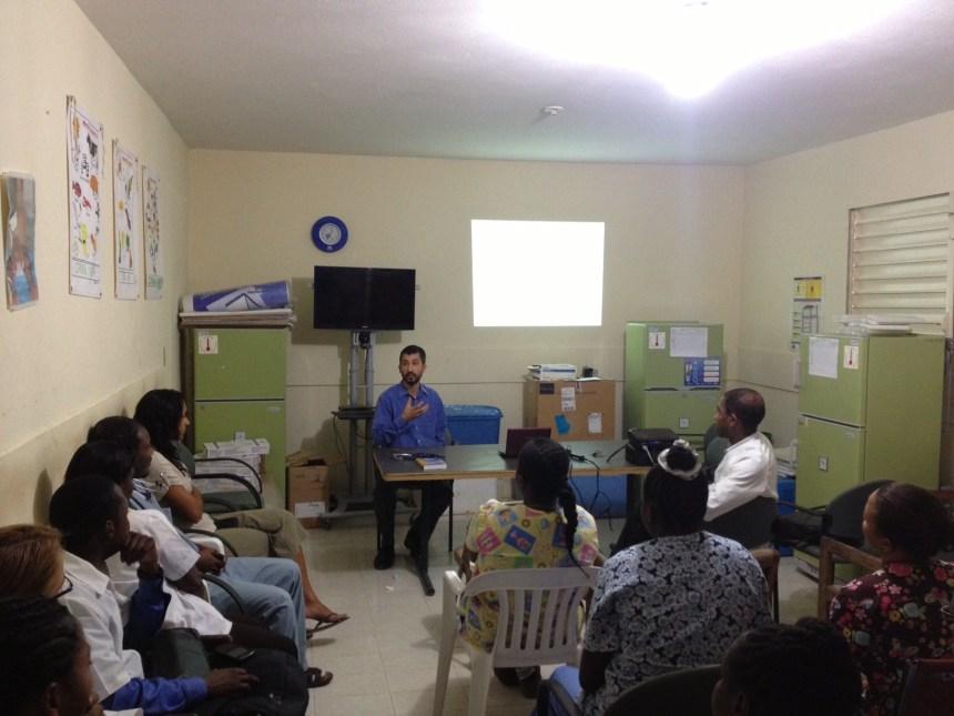 Aaron Berkowitz teaches clinicians in Haiti.