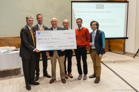 Sabatine and Anderson presented Michael Brenner (third from left) and his team with a BRI Director's Transformative Award.