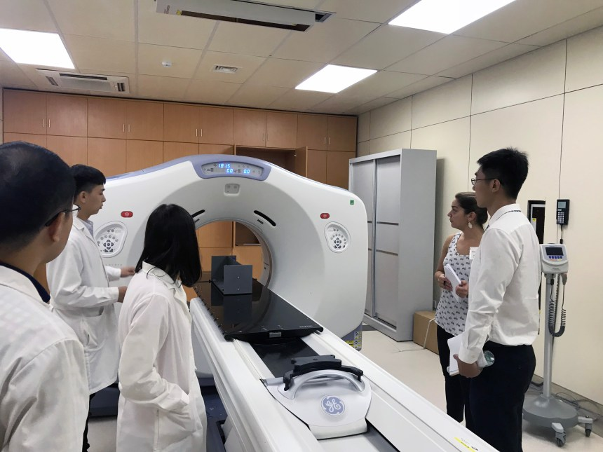 Monica Batchelder (second from right) and Boao Evergrande staff view BEIH's linear accelerator, which provides radiation therapy.