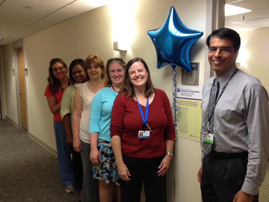 The BWH Family Care Associates team gathers for a group photo on its opening day. From left, Carlotta Starks, RN; Luz Solano; Cynthia Hinthorne; Kitty O'Hare, MD; Colleen Monaghan, MD; and Niraj Sharma, MD, MPH.