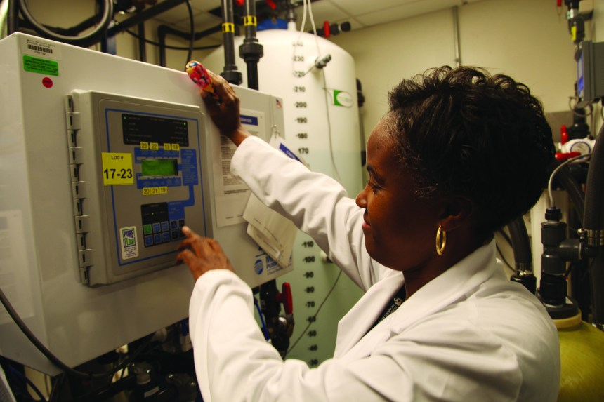Cynthia Hargrove works on the reverse osmosis water system for dialysis, one of many technologies overseen by Biomedical Engineering.