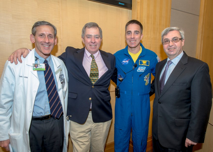 BWH cardiologist Dale Adler, patient Jack Cassidy, NASA astronaut Chris Cassidy and cardiac surgeon Sary Aranki gather for a group photo after surgery grand rounds.