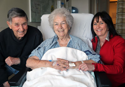 BWH patient Mary Walsh (center), with husband, Joe Walsh, and daughter, Veronica Walsh