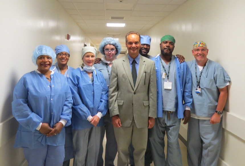 In August, the BWH neurosurgical team (L to R: Sandra Lawson, Shivon Cesar, Susan Corrigan-Sheehan, Misty Adhikari, Ennio Chiocca, Ray John, Jean Dyer, Sean Jackson) successfully performed the 600th case in the Advanced Multimodality Image Guided Operating (AMIGO) suite, involving a craniotomy to resect a brain tumor. Not pictured: Roman Portnoy and Walter Surrette.