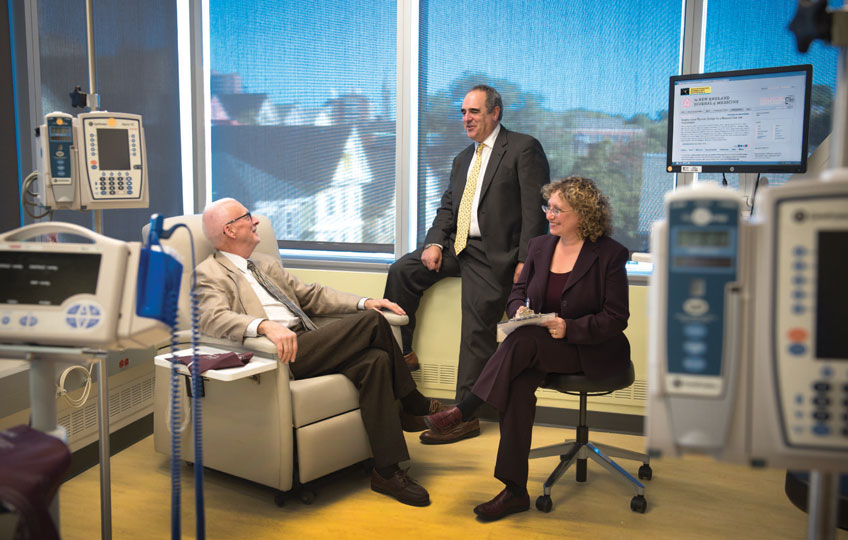 approachingtruth1_bob-okeefe-left-meets-with-his-rheumatologist-jeffrey-katz-md-mmsc-and-elena-losina-phd-in-the-new-clinical-trials-center-in-the-building-for-transformative-medicine