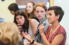 Taralyn Tan, a curriculum fellow at HMS, poses a question during the 2018 WBI Symposium.