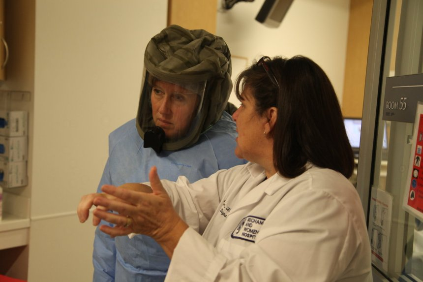 Emergency Medicine Nurse Director Janet Gorman (at right) speaks with ED staff nurse Mary Lou Stock during an ED drill.