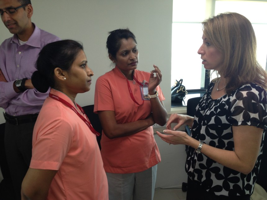 BWH nurse practitioner Michelle Young (far right)  speaks with nurse colleagues in India.