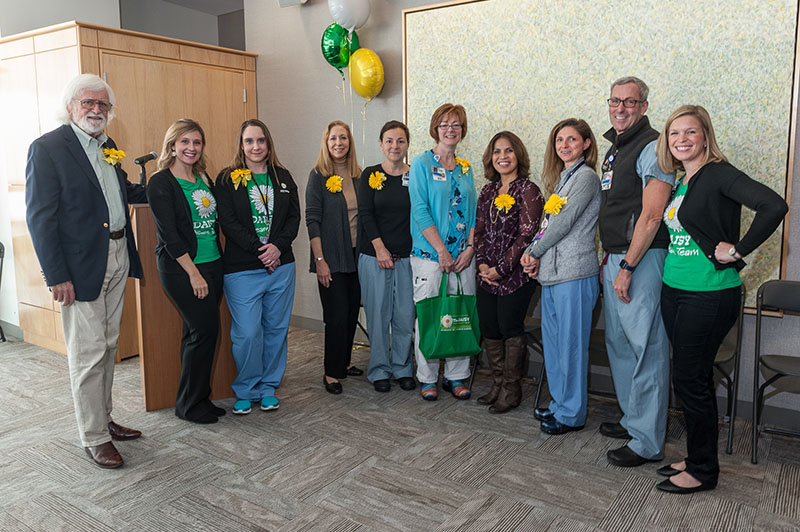 The Barnes' began the DAISY nurse recognition program after the passing of their son. The Barnes' were greeted in the main lobby by Maddy Person, CNO, and nursing leadership who had big DAISY balloons and then they walked over to the Shapiro Porch for the formal DASIY event.