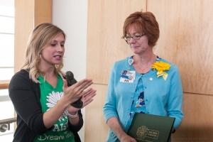 Rachel Hurd presents the Healer's Touch statue to Cathy Benedict.