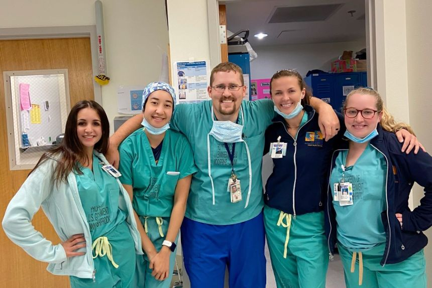 Brigham nurses who volunteered in Shiprock recently gathered with NNMC nursing manager Scott, center. From left, Mallory-Anne Perron, Victoria Wroblewski, Stephanie Pretty and Ashleigh Golden. Photo courtesy of Stephanie Pretty.