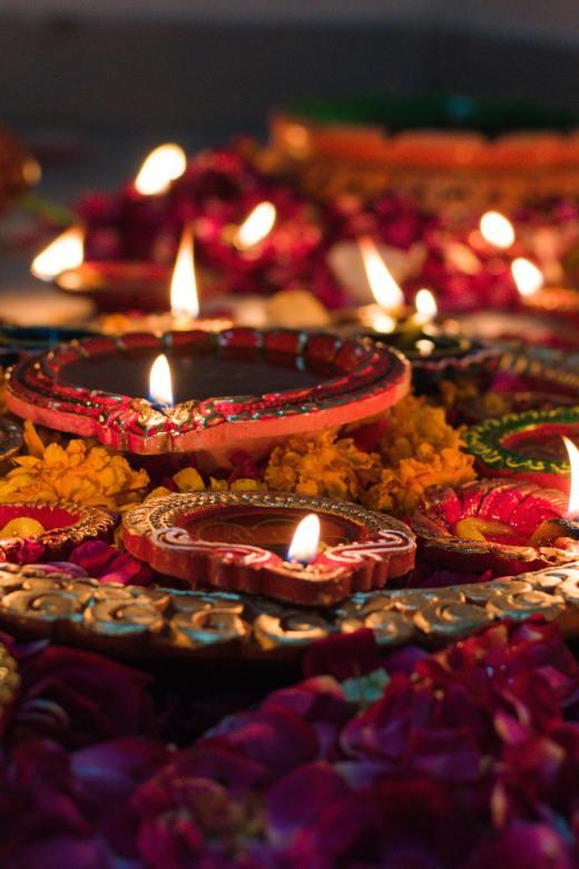 Image of lit candles. Photo by Udayaditya Barua on Unsplash.