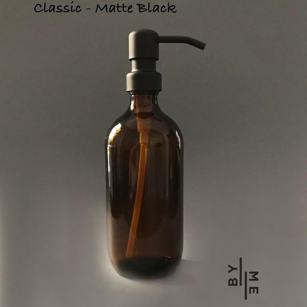 amber glass bottle with matte black metal pump