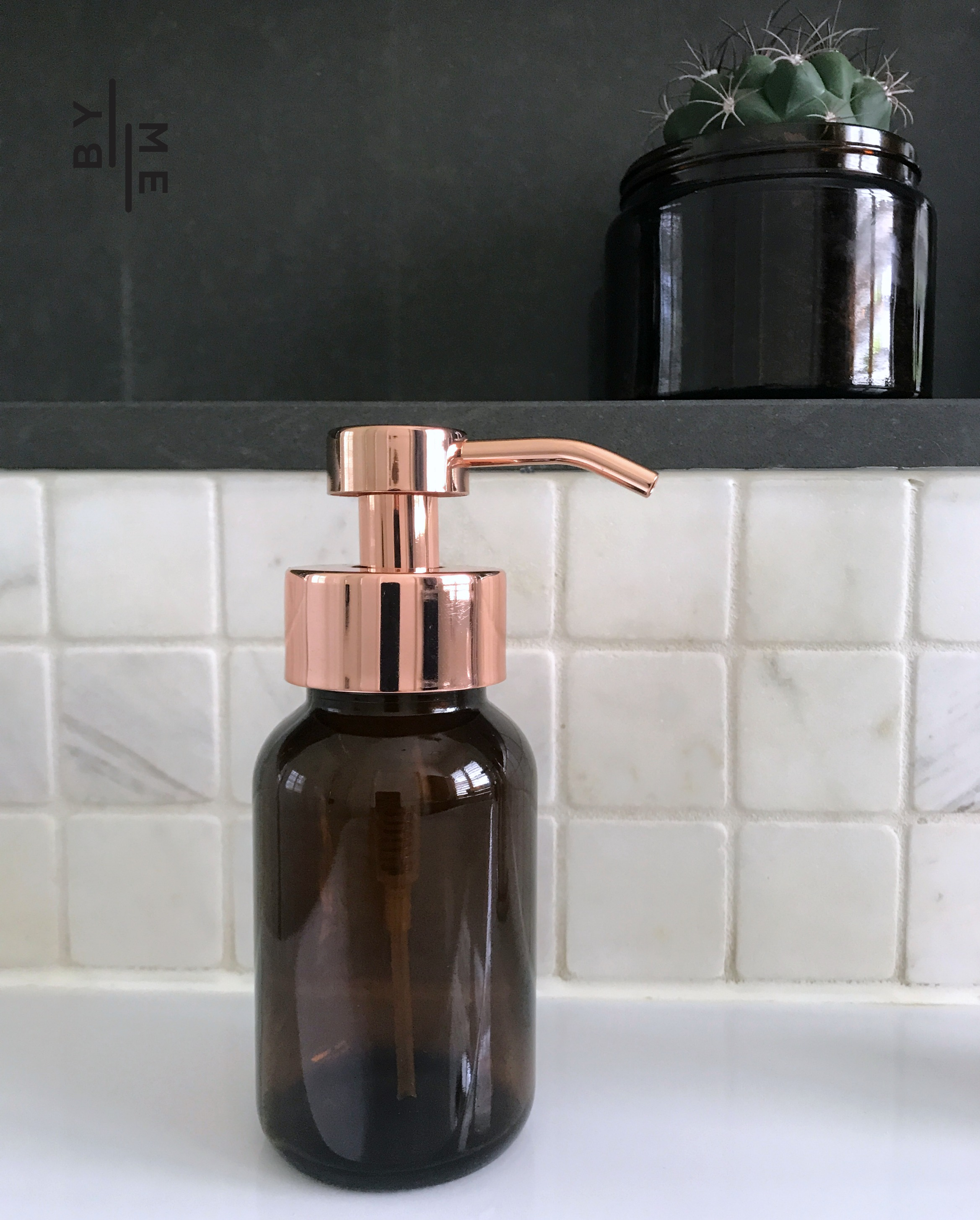 Glass foaming soap dispenser with rose gold pump