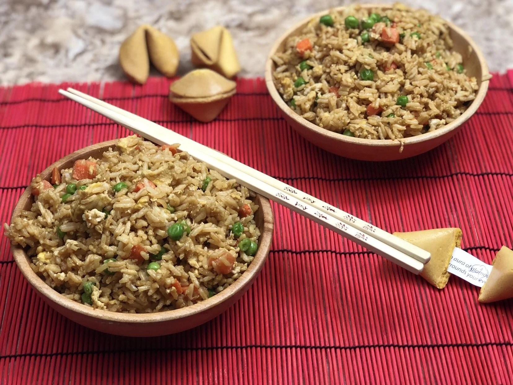 Forget ordering takeout and make your own Instant Pot Fried Rice that tastes better than takeout!  Thisfried rice in your instant pot is a straightforward recipe that gives your takeout flavors in under 10 minutes to make. #friedrice #instantpot #easy #easyrecipe #carrots #peas