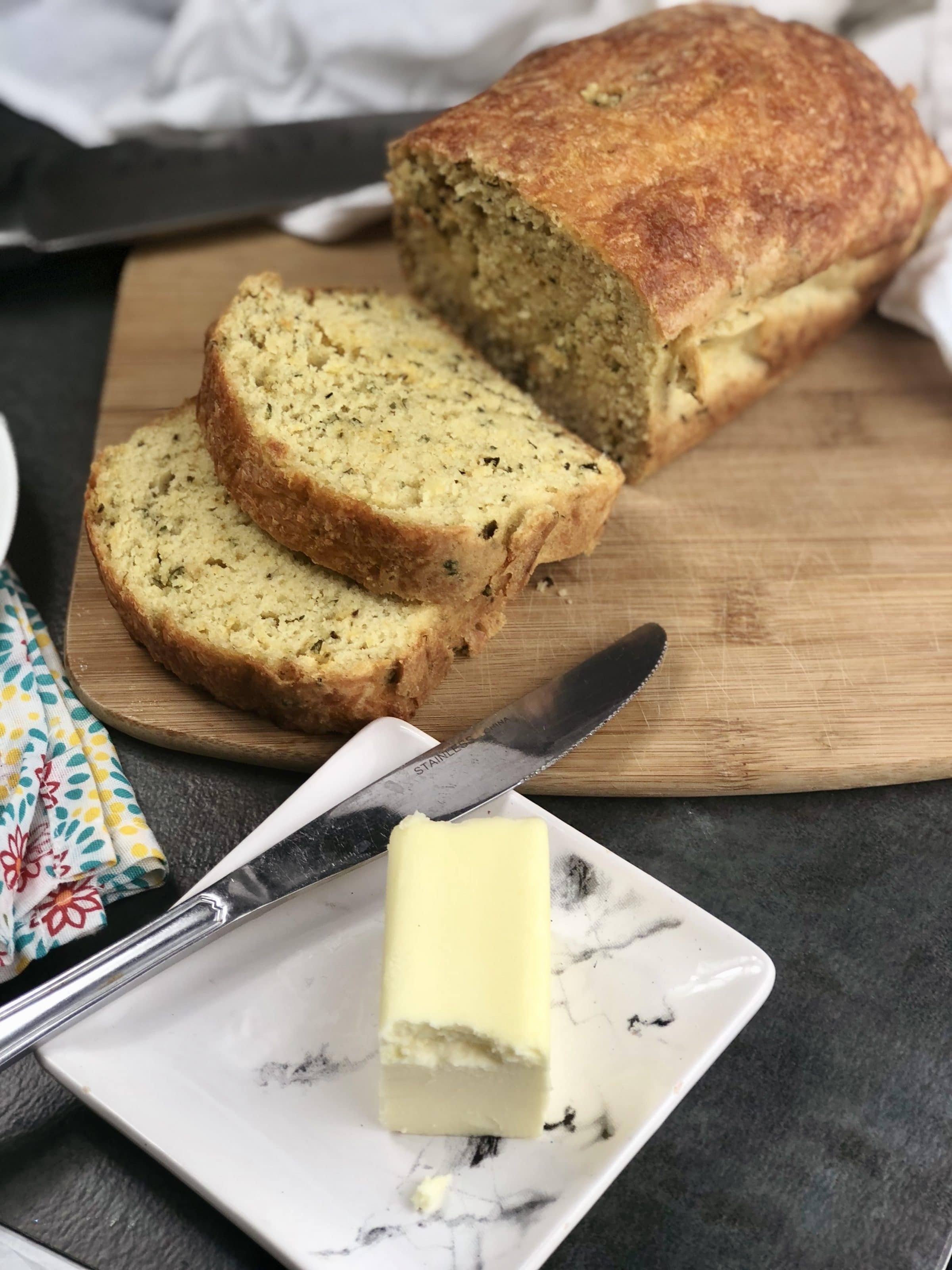 This cheddar garlic herb keto bread is a must make if you are following the keto diet. It is a keto bread that uses almond flour and a nice low carb bread to fill those cravings. #keto #lowcarb #ketobread #cheddargarlicherb