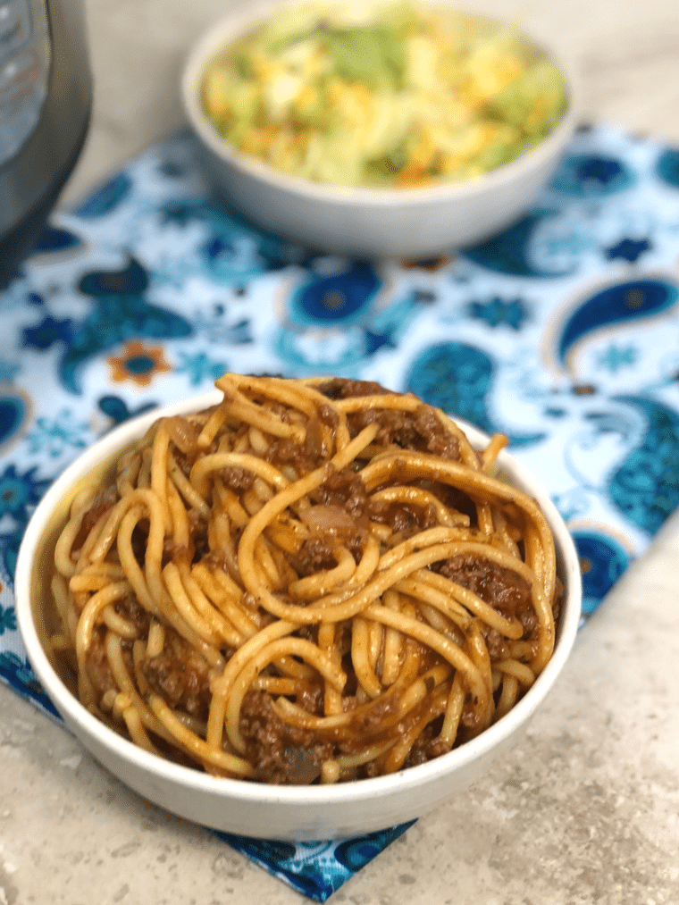 This one-pot Instant Pot Spaghetti will amaze you with the beautiful blend of flavors and ease of cooking. No more having a pot of boiling water for noodles, pan for meat sauce, and a ton of dirty dishes. #instantpot #spaghetti #pasta #noodles