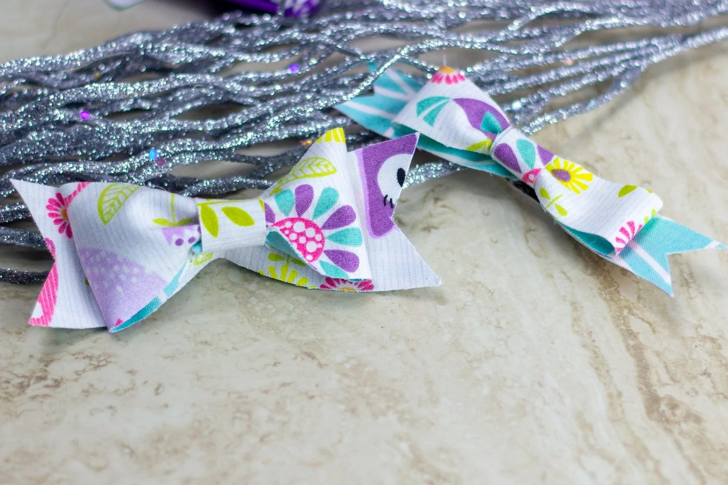 2 bows made from colorful fat quarters