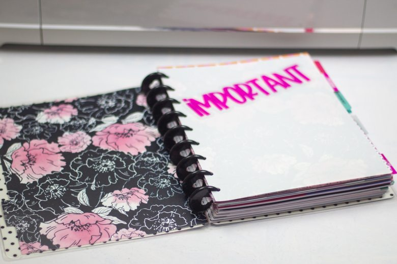 dollar tree binder with sticker on the plain side that says important cut into personal planner dividers for the happy planner