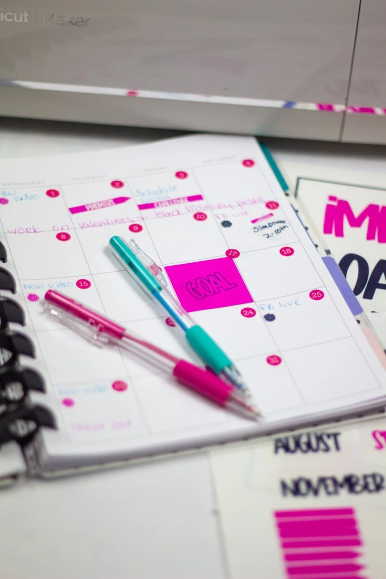 happy planner with free printable goal planning stickers pink and black