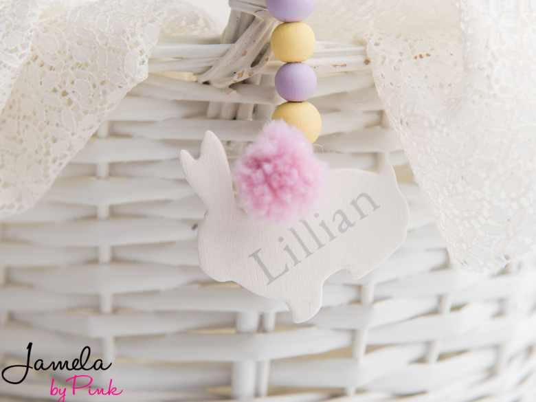 white wicker easter basket close up with personalized easter basket tag