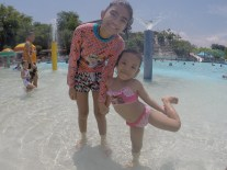 sisters at the kiddie pool
